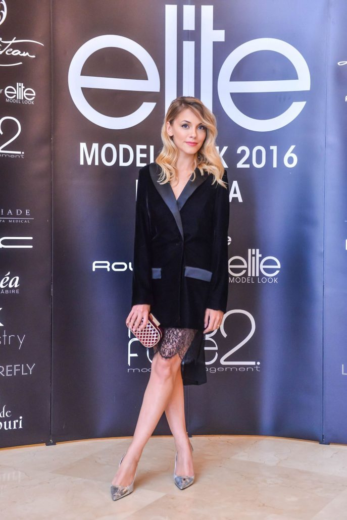 Beautiful blonde Andreea Ibacka wearing the black velvet jacket with open back cut and silk bow 2 / 2